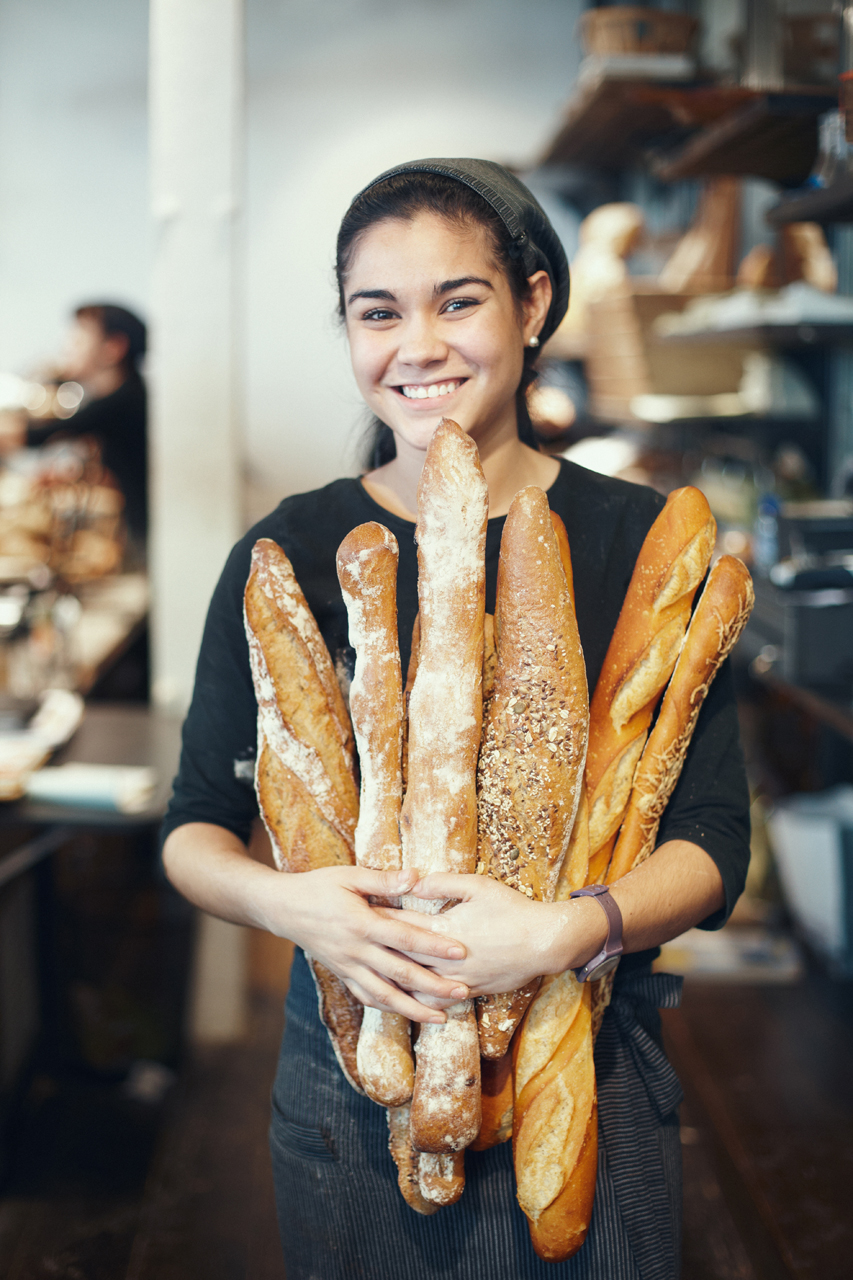 Saleswoman holding bread
