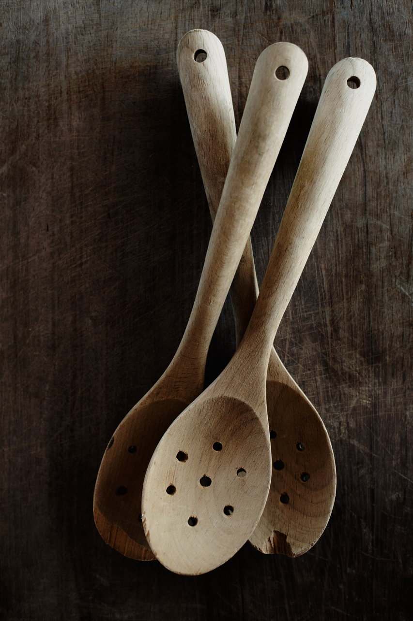 Three wooden spoons on a chopping board